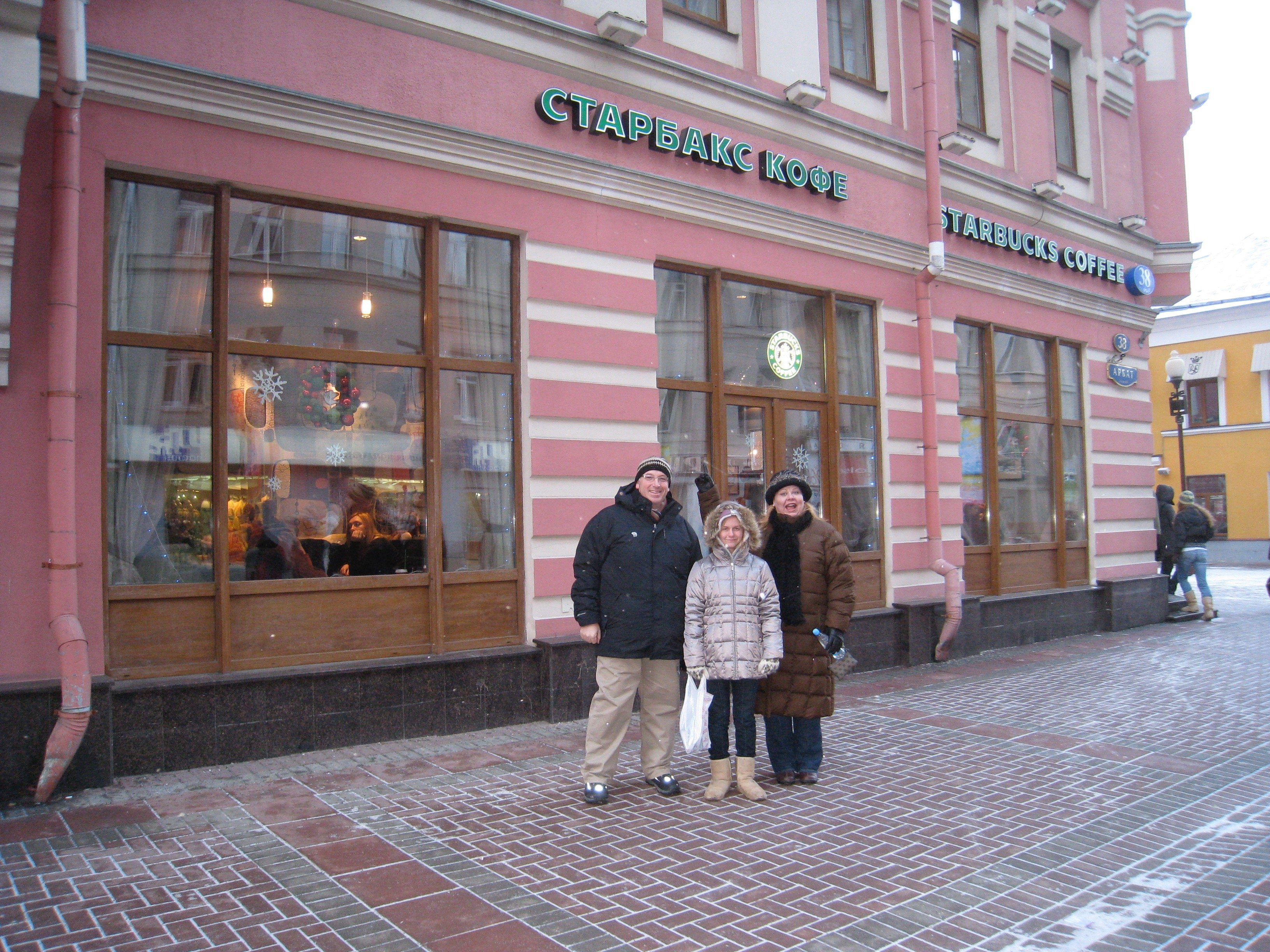Banks Fam in front of Starbucks on Arbat St in Moscow